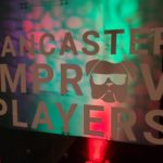 Lancaster Improv Players logo on a green and red background